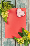 Valentines Day with heart. Heart and flowers with place for text on red background Royalty Free Stock Images