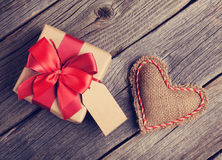 Valentines day heart and gift box. Valentines day toy heart and gift box on wooden table. Retro toned Royalty Free Stock Photos