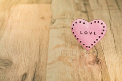 Valentines Day heart with inscription. Pink heart with place for text on the wooden background Royalty Free Stock Photos