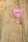 Valentines Day heart with inscription. Pink heart with place for text on the wooden background Royalty Free Stock Photo