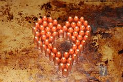 Valentines day heart made out of 9mm bullets. Bullets are on a rustic metal background Royalty Free Stock Image