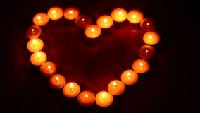Valentines day heart shaped candle stock footage