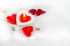 Valentines Day heart shaped candles and rose petals on white background  Stock Photo