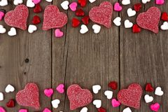 Valentines Day heart shaped candy double border on rustic wood Stock Image
