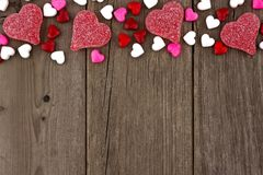 Valentines Day Heart Shaped Candy Top Border On Rustic Wood Royalty Free Stock Photos