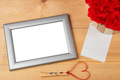 Valentines day heart shaped red ribbon and blank photo frames Royalty Free Stock Photo