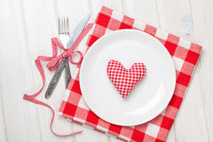 Valentines day heart shaped toy gift on plate with silverware Stock Images