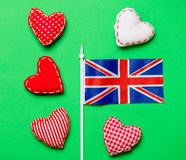 Valentines Day heart shapes and flag of Great Britain. On green background Royalty Free Stock Images