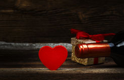 Valentines Day. Heart, Wine And Gift. Red Heart, Wine And Gift Box On Old Wooden Board. Valentines Day Concept Stock Images
