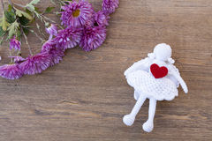 Valentines day hearts and angel and flowers on wooden table Stock Image