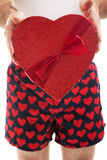 Valentines Day Hearts and Boxers. Guy in his heart boxer shorts giving a valentines day box of chocolates to you stock photo