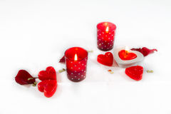 Valentines Day hearts,  candles and rose petals on white backgro Stock Image