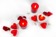 Valentines Day hearts,  candles and rose petals on white backgro Stock Photo