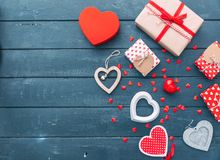 Valentines day hearts and gift box over wooden table royalty free stock photography
