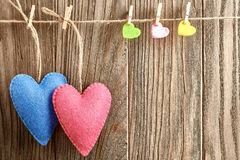 Valentines Day. Hearts Handmade Couple. Love concept. Valentines Day. Hearts Handmade Couple, hanging on rope. Love concept on wooden background Royalty Free Stock Images