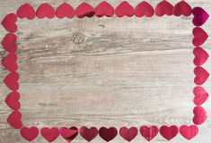 Valentines day. Hearts on a wooden plate stock images