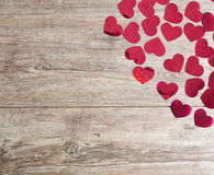 Valentines day. Hearts on a wooden plate stock photos