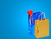 Valentines Day holiday gift bags with red heart on blue backgrou Royalty Free Stock Image
