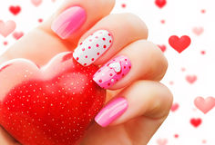 Valentines Day holiday manicure. Valentine day holiday nail art manicure royalty free stock photos