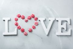 Valentines day holiday text word love with pink meringue heart Royalty Free Stock Image