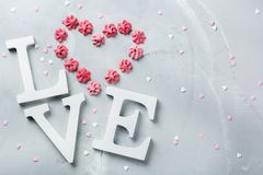 Valentines day holiday text word love with pink meringue heart Stock Photos