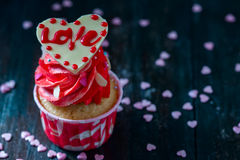 Valentines Day homemade cupcakes with pink icing. Royalty Free Stock Photos