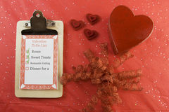 Valentines day list on red background Stock Image