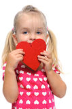 Valentines day for little girl. Sweet little girl holds a valentines heart and thinks of love, isolated on white Royalty Free Stock Images