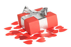 Valentines Day love gift. Valentines Day gift in red box and small hearts isolated on white Royalty Free Stock Image