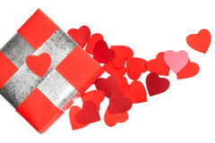 Valentines Day love gift. Valentines Day gift in red box and small hearts isolated on white top view Stock Photography