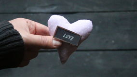 Valentines Day or love idea. Valentines Day or love heart idea, hand holding a heart, vintage style stock footage