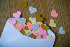 Valentines day love letter. opened envelope and many felt hearts. Empty copy space stock images