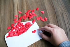 Valentines day love letter. opened envelope and many felt hearts stock image