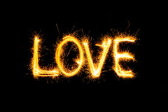 Valentines Day - Love made a sparkler on black Stock Images