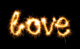 Valentines Day - Love made a sparkler on black Royalty Free Stock Photos