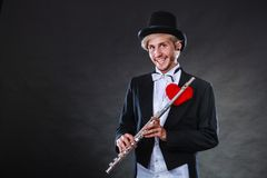 Male flutist with flute and heart. Love melody Stock Photos