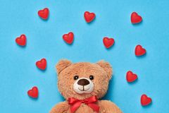 Valentines Day. Love.Teddy Bear with Sweets Hearts. Valentines Day. Love. Teddy Bear with Candies Sweets Hearts. Minimal. Art. Cute bear on Red hearts background Royalty Free Stock Photography