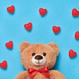 Valentines Day. Love.Teddy Bear with Sweets Hearts. Valentines Day. Love. Teddy Bear with Candies Sweets Hearts. Minimal. Art. Cute bear on Red hearts background Stock Photo