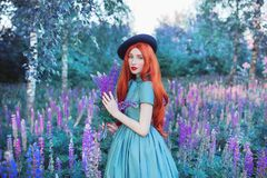 Valentines Day lupine background. Spring stylish wear. Awesome girl with red lips and nails in dress. Summer flowers. Awesome stock image