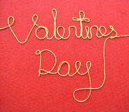 Valentines day made from wire on red background Royalty Free Stock Photos