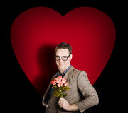 Valentines day man with flower bunch on love heart Royalty Free Stock Images
