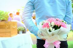 Valentines day. Man hiding behind a bouquet of flowers. Handsome. Man waiting for his girlfriend, boyfriend surprise girlfriend with flower in valentine`s day Stock Photos