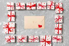 Valentines day mock up. envelope in gift boxes frame on cement background. Valentines day card concept stock photos