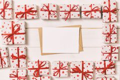 Valentines day mock up. envelope in gift boxes frame on wooden vintage toned background. Valentines day card concept royalty free stock image