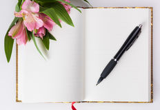 Valentines day, Mothers day composition. Love diary and fresh spring flowers. Royalty Free Stock Photography