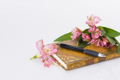 Valentines day, Mothers day composition. Love diary and fresh spring flowers. Royalty Free Stock Photo