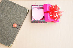 Valentines day with note and hearts in box background Stock Photos