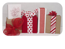Valentines Day packages 3. Red, white and brown paper wrapped packages on a white background.  lots of room for your copy below the packages Royalty Free Stock Photography