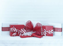 Valentines Day packages. Red and white s day packages on a white background with lots of room for your copy above the packages Stock Photos