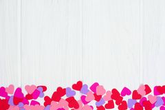 Valentines Day paper heart bottom border against white wood Royalty Free Stock Photography
